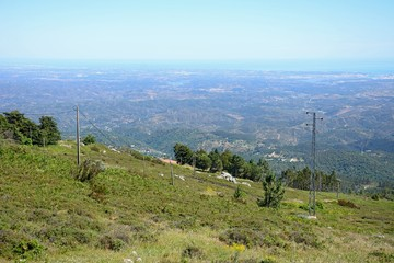 Elevated view across the Monchique mountains and countryside towards the coastline, Algarve, Portugal.