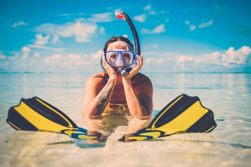 Snorkeler woman having fun on the tropical beach