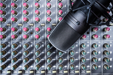 condenser microphone on audio mixer. recording & broadcasting concept
