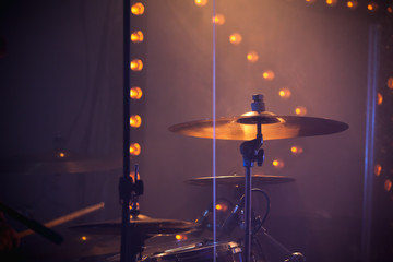 Rock drum set with cymbals and stage lights