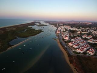 Cabanas de Tavira en Portugal, localidad costera de Tavira en el distrito de Faro, región del Algarve. Fotografia aerea con Drone