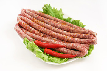 raw sausage with pepper
