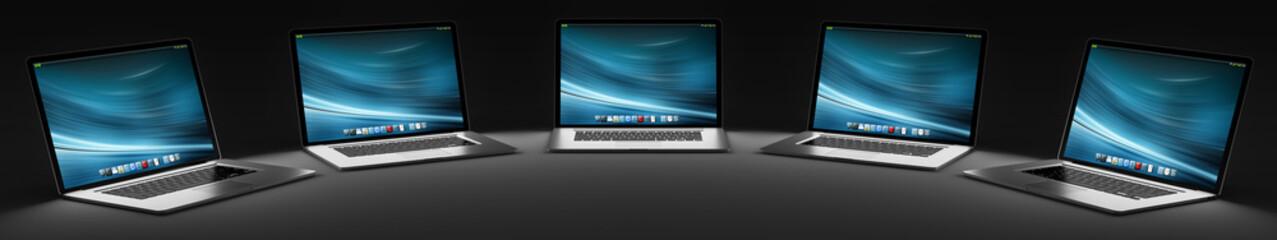 Five modern laptop in the dark 3D rendering
