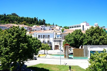 Elevated view of the village with a park in the foreground, Monchique, Algarve, Portugal.
