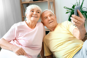 Senior couple exercise together at home health care selfie photos happy