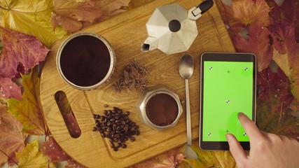 Autumn still life. Chroma key tablet and coffee