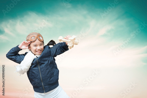 Imagination Inspiration And Creative Learning Motivation Education Concept With School Girl Child In Pilot Costume