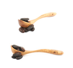Wooden spoon of cocoa beans isolated