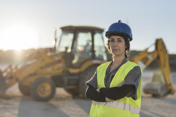 Worker woman looking at camera after working in sunset image