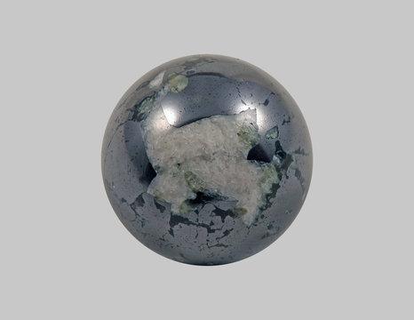 Stone is magnetite, round.