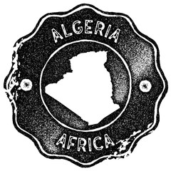 Algeria map vintage stamp. Retro style handmade label, badge or element for travel souvenirs. Black rubber stamp with country map silhouette. Vector illustration.