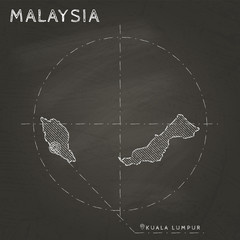 Malaysia chalk map with capital marked hand drawn on textured school blackboard. Chalk Malaysia outline with Kuala Lumpur marked. Vector illustration.