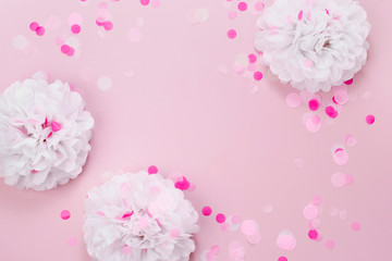 Pink and white Paper Decorations for Baby party. Flat lay, top view