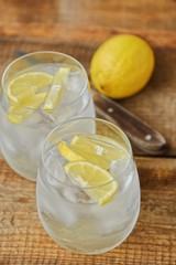 Fresh lemonade with ice and lemon on the table