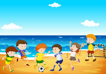 Boys playing soccer on the beach