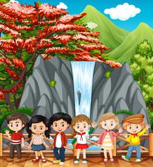 Happy children visiting waterfall