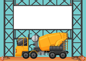 Construction site with blank board and cement truck