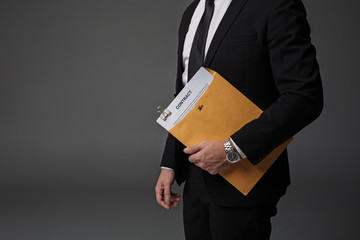 Close up businessman arm keeping contract in folder. Career concept. Isolated and copy space