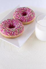 Donut cakes isolated on white background with glass of milk