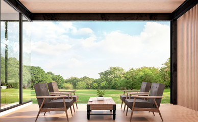 Wood pavillion with garden view 3d rendering image.There are woodden floors,wall and ceiling .Furnished with brown leather and wood furniture. Surounded with the large garden.