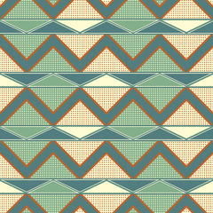 Seamless geometric pattern with zigzag and dots in retro colors