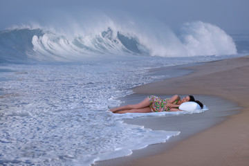 Beautiful brunette sleeping on a beach dreaming about sea