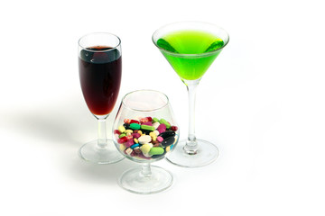 wine, liquor and medical pills in glass
