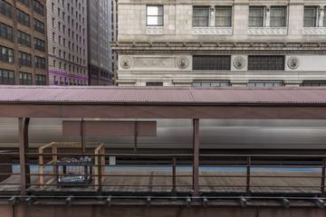 Blurred train leaving platform
