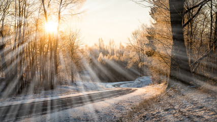 empty road in the countryside in winter - light rays effect