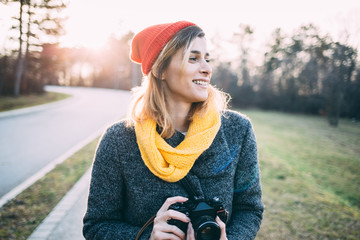 Hipster woman with retro camera