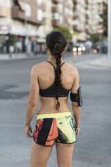 Runner woman in city training, back view.