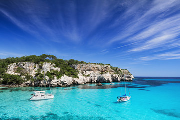 Beautiful bay with sail boats, Menorca island, Spain. Sailing and yachting concept