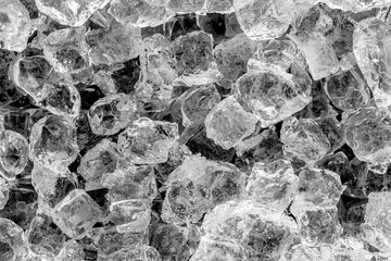 Ice cubes on black background.