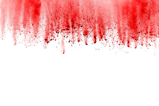 Red powder explosion on white background. Colored cloud. Colorful dust explode. Paint Holi.