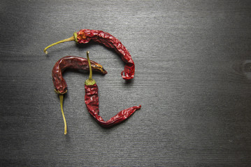 dried red chillies on a black table