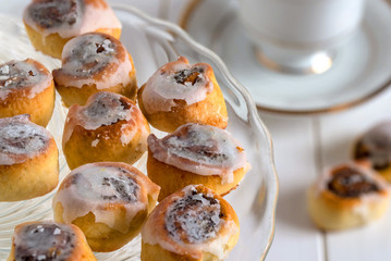 Poppy seed cakes. Mini rolls with poppy seed and icing sugar.