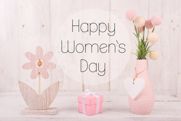Flowers composition for Women's Day. Pink flowers on old white wooden background.
