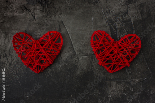 Two Hearts With A Plus Sign Against A Dark Background Theme For St