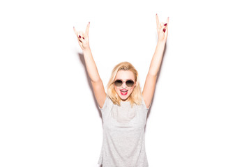 Style woman with emotional fashion short hair blonde. Crazy girl in t-shirt and rock sunglasses scream hand over head. Rocky woman on white background