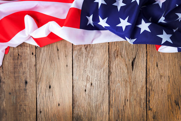 american flags on old wood for background.