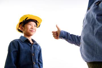 Engineering Thai Asian boy in yellow helmet
