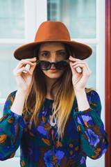 Cheerful stylish woman in hat