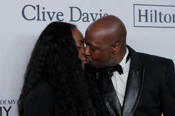 """Musician Wyclef Jean arrives with Claudinette Jean for the 2018 Pre-GRAMMY Gala & GRAMMY Salute to Industry Icons presented by Clive Davis and The Recording Academy honoring Shawn """"JAY-Z"""" Carter in Manhattan, New York"""