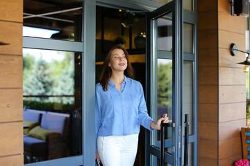 Gladden female customer leaving restaurant with close up satisfi