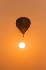 silhouette of balloon with sunset