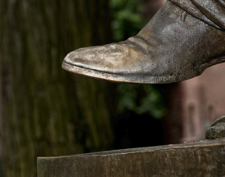Yale Univ. Statue: Worn toe of statue of Yale University President Theodore Dwight Woolsey, The toe of the shoe was touched and rubbed by many people over the years making it smooth and shiny.