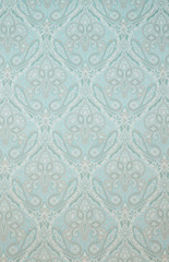 Textured Fabric Background with Floral Swirls and Paisley Designs