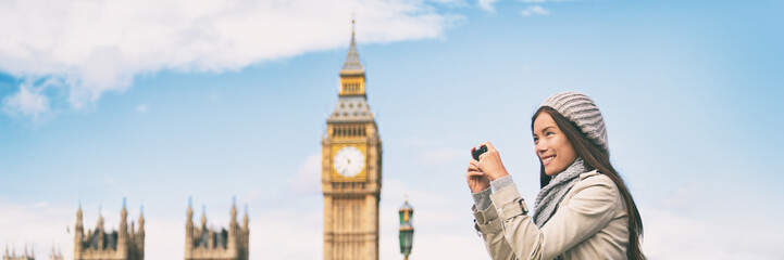 London europe travel woman taking pictures with phone panorama banner. Tourist holding smartphone camera taking photos at Big Ben, Westminster Bridge, London, England.