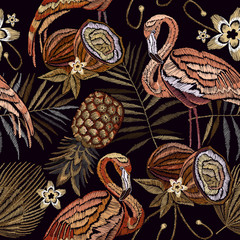 Embroidery vintage flamingo , palm tree leaves, pineapple, coconut tropical seamless pattern. Fashionable embroidery pink flamingos, tropical summer background. Template for design of clothes