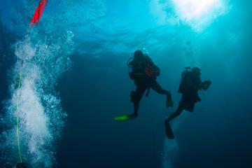 undersea maldives, two aqualungers